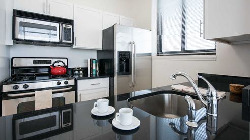 Model unit at 180 Montague Street with contemporary kitchen and appliances