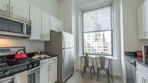 Eat-in kitchen with stainless steel appliances at 71 Broadway