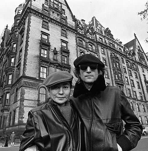John Lennon and Yoko in front of the Dakota