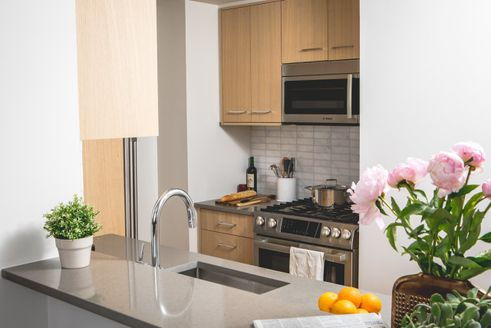 Model kitchen at One Columbus Place in Manhattan