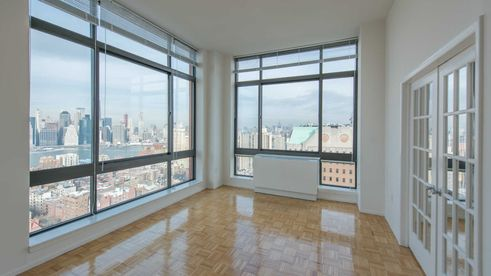 Model unit at 180 Montague Street with view of Manhattan