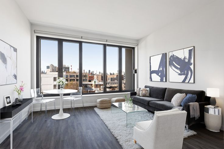 Airy apartments and large windows define the apartment of LINE LIC (All images via Modern Spaces)