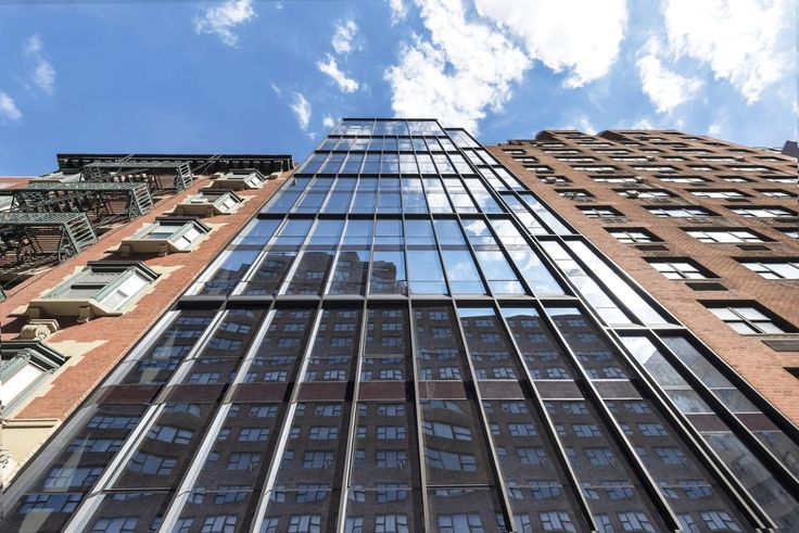 Looking up at The LES's sleek curtain wall (Modern Spaces)