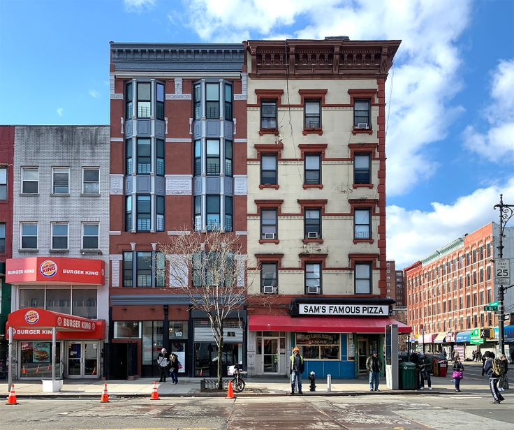 152 East 116th Stret (red brick with the baby blue trim) has two-bedroom co-ops available for $209K (Ondl/CityRealty)