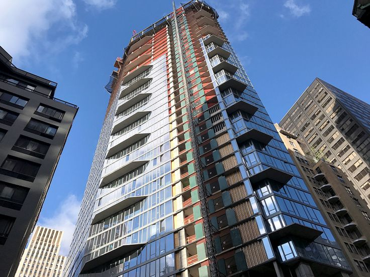 Looking up at the toppedout structure of 222 East 44th Street; CityRealty