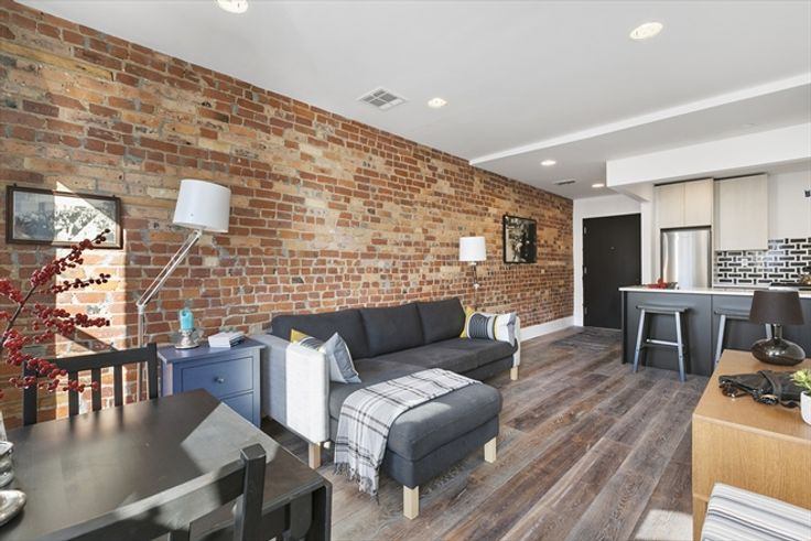 923 Bedford Avenue in Bedford-Stuyvesant, Brooklyn was recently renovated and converted to a 6-unit rental. (Image via Corcoran)