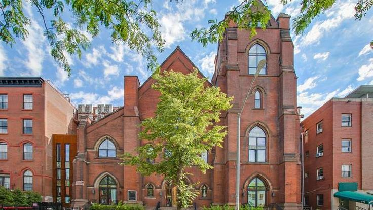 The former St. Vincent de Paul Church at 163 North 6th Street was converted to rental apartments in 2014. (Image via EXR Group)