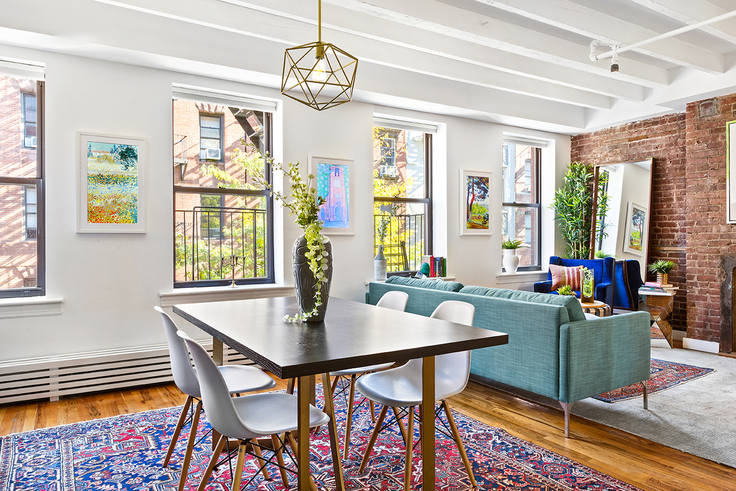 This one-bedroom at 243 Mulberry in NoLita is listed for a fraction of its market rate price (Corcoran)