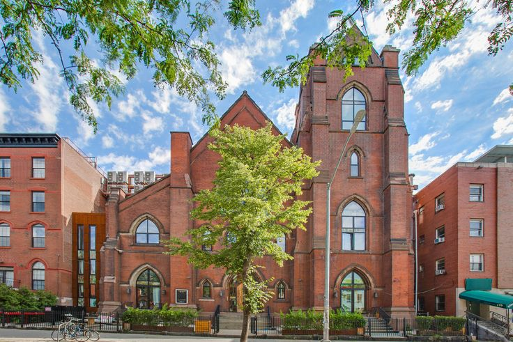 A highly coveted rental is below this beautifully restored facade. (The Spire Lofts via All Year Management LLC)