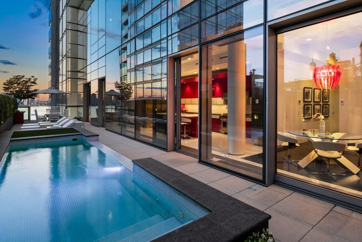 Another super-luxe building amenity? No - a private pool with a penthouse! (166 Perry Street via Nest Seekers)