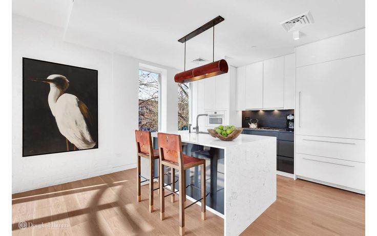 Open concept, impeccably designed kitchen at 505 2nd Street; Via Douglas Elliman