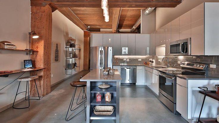Apartments at Modera Lofts in Jersey City have 12-foot ceilings, original wood beams, and exposed masonry. (Image via moderalofts.com)