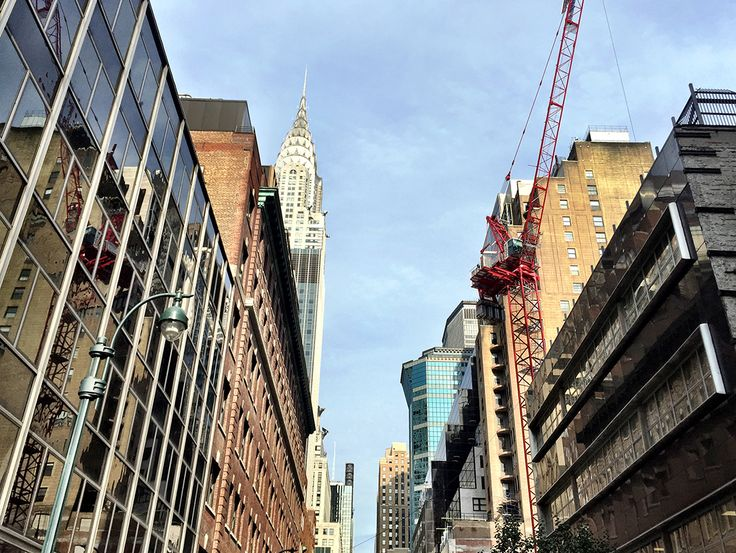 Photo looking down East 43rd Street, with the crane of  222 East 44th on the left