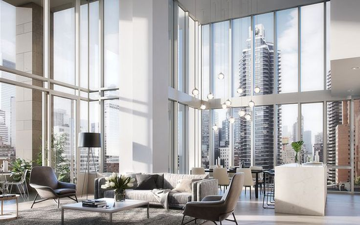 The building's duplexes feature double height ceilings that expand upon the sweeping views offered by floor-to-ceiling glass windows.