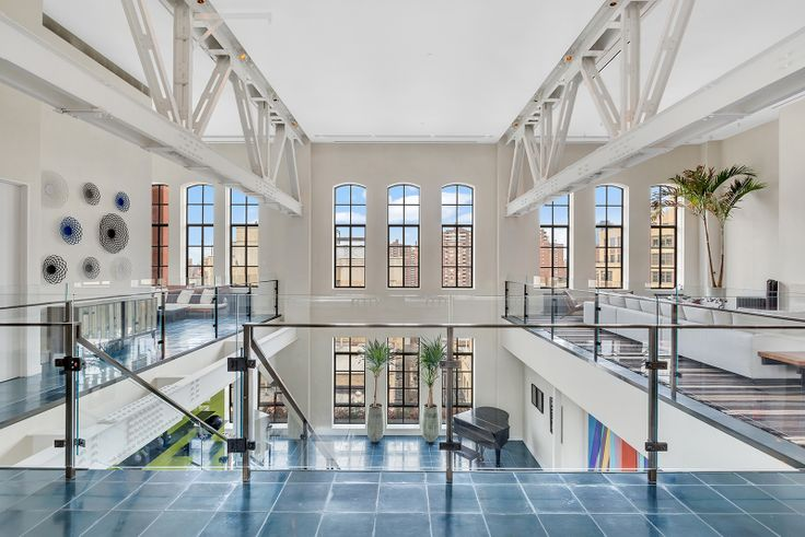 The sprawling duplex is back on the market! 213 West 23rd Street; Image via Core