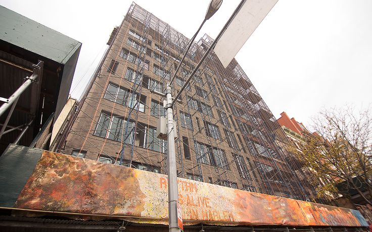 Greystone Development commissioned artist Lance Johnson to create a mural for its new residential property at 69 East 125th Street.