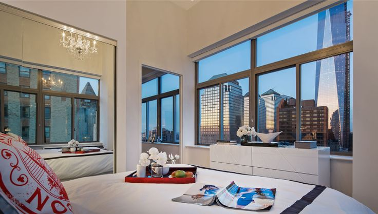 Model residence at 90W with views of 1 WTC, via Moinian Group