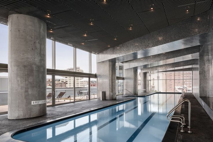 A 75-foot pool overlooks the building's massive terrace;