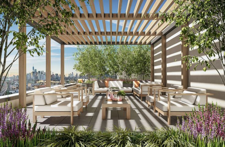 Arbor Eighteen's common roof deck has grills and dining area