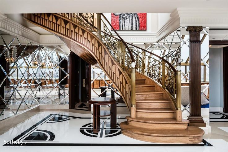 Grand custom-made staircase in the Plaza's #PH 2003