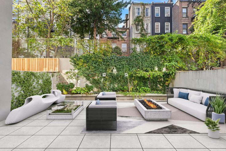 A private backyard at the Chelsea condo Modern 23 (via Compass)