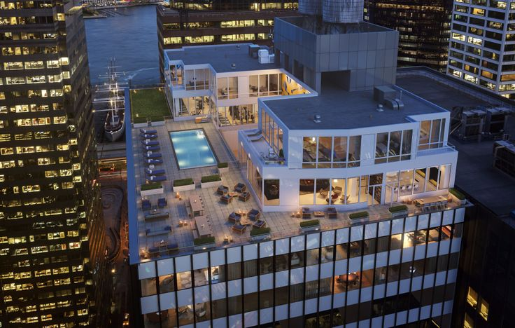 The building's 180 Club is a collection of amenities that includes a luxurious rooftop pool overlooking downtown. (Image via 180waterst.com)