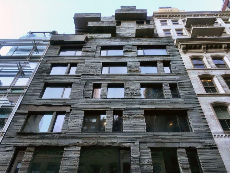 Looking up at 12 Warren's rugged bluestone facade