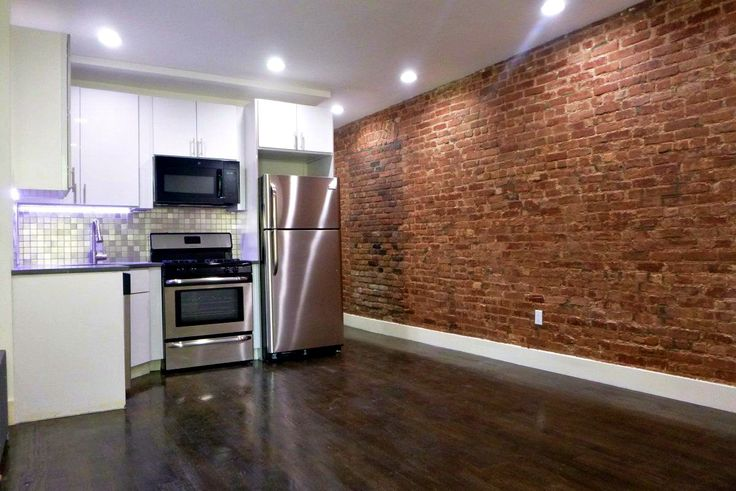 Newly renovated interiors at 100 West 143rd Street in Harlem (Image via Bohemia Realty Group)