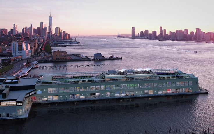 Aerial view of Pier 57 looking south at dusk (RXR Realty/Young Woo & Associates)
