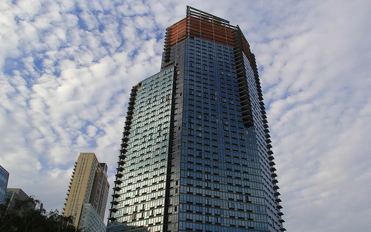 The Hayden stands at 43-25 Hunter Street in LIC, featuring a distinctive glass facade.