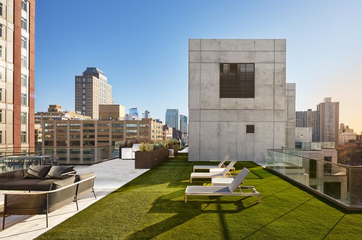 98 Front Street's common roof deck has grills and dining area