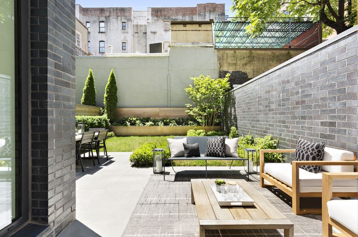A scene from suburbia? Hardly - it's the private backyard of a Lower East Side maisonette! (287 East Houston Street via Corcoran)