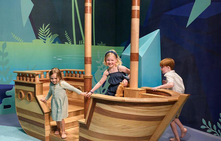 Waterline Luxury Rentals - Amenities - Children in a Play Boat